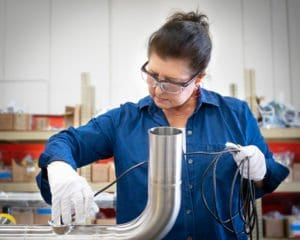 A quality assurance consultant conducts a borescope inspection of a stainless steel pipe