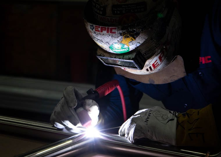 An EPIC craftsman performs a TIG weld