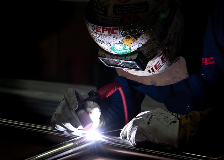 This welder is conducting a TIG weld during skid fabrication