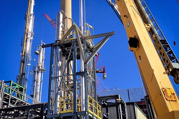 A distillation tower is installed at a refinery
