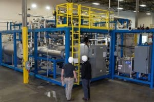 A large process system pictured in EPIC's shop gets examined by EPIC process engineers