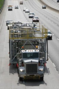 A distillation pilot plant is transported down a highway