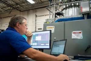 An EPIC control engineer conducts FAT on an industrial automation system