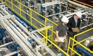A team inspects system at the process engineering firm's facility