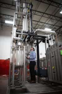 A member of the EPIC QA team inspects distillation equipment ready for shipment