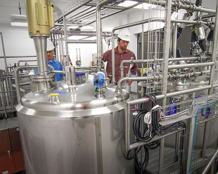 A pair of EPIC process engineers oversee installation of a modular food processing plant