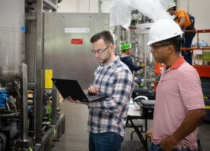 An engineer consults with a process engineering consultant