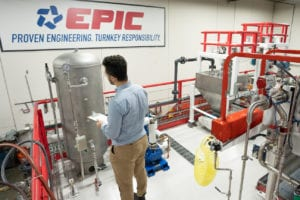 A hydrogenation system is inspected by an EPIC project manager