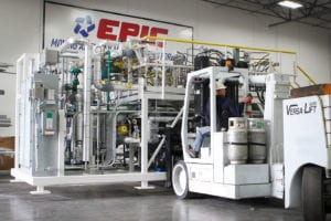 Modular process systems get moved with a fork lift in EPIC's shop