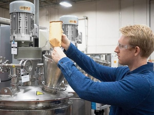 An Apeel engineer conducts FAT on new powder liquid blending systems
