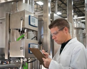 Engineer inspecting an industrial automation and controls system