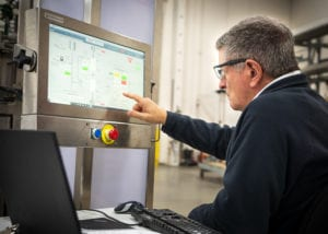 An industrial automation services provider configures a process using an HMI
